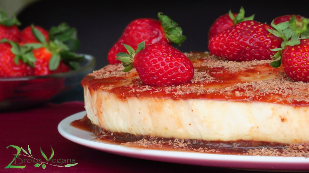 Gluten Free Vegan Cheesecake Recipe topped with Strawberries on a Chocolate Crust